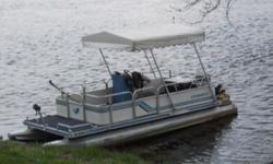 We bought this 18' Kennedy pontoon boat in St. Paul, MN on September 2014, in excellent working order and an overhauled 35 HP Mercury outboard motor. Starts right up 7mpg.In order to make the trip down the Mississippi to New Orleans, we added the