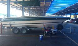 this is an amazing boat don't have any room for it. 1988 sea ray S23 Sorrento. single engine 360 HP never had any issues. 260 mer cruser with a alpha 1 outdrive. V8. $ 500.00 mirage prop. no rips on seats paid about 5000.00 for upholstery five years ago.