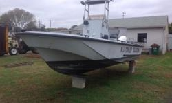 It is set up for emergency use. It has overhead blue lights and side spotlights mounted on a hinged center console aluminum rack. The boat is 20 ft long and 7 ft wide. The hull is in good shape. It has a live well built into the floor, bildge pump, side