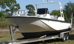 1989 25 ft. Boston Whaler Outrage with a 1996 225 hp. Evinrude Ocean Pro motor, just serviced, and a 1999 Continental torsion bar aluminum trailer. This hull was originally built as a guardian and is heavily built and very strong. It is now set up for
