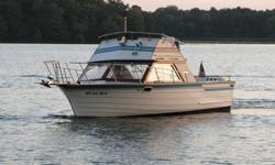 Stock Number: 710630. Very low hours (under 300), All mahogany interior, Extensive electronics ? stereo, VHF radio, chart plotter, speed/temp/trip log, radar unit (includes dome, not installed), and autopilot. 240 Hp Chrysler Inboard, Remote spotlight,