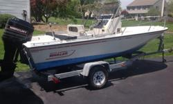 Nice 1990 Boston Whaler 17 Outrage center console.Hull is in very good condition.Large anchor locker in bow with drain.Cooler seat.Rod holders on console.Hummingbird fish finder.VHF radio.CD stereo radio with external speakers.Compass.Reversible helm