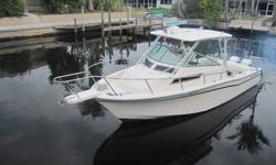 You are looking at a 1990 Grady White Marlin 28 Walk~Around powered by twin year 1999, 225hp Johnson Saltwater Offshore 2 stroke motors. The 1990 Grady White model Marlin 28 is the exact same size as the 1995-present Grady White Marlin 30. They just