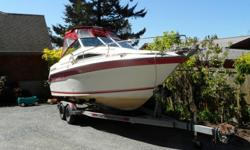 """Family cruiser -- this boat has given us countless hours of enjoyment. EZ Loader tandem axle trailer included23' 8"""" in length with swimstep / motor mount.Mercruiser 5.0LX (230 HP) with Alpha One outdrive, which was just serviced (end of Aug). 595 hours."""