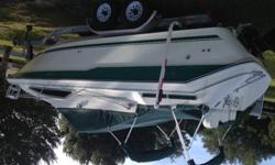 It has a brand new complete rebuilt 5.7 mercruiser with 5 hours on it.Windlas , vberth,bedroom,head,new corian counter with sink, fridge am/fm stereo,power inverter,halon system,new freshwater pump, 2 batteries,camper canvas,cockpit cover, fender holder