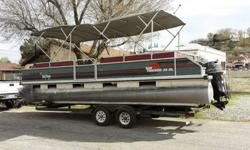 """? 22 oz. sculptured marine-grade carpet? 8'6"""" (2.59 m) beam for expanded space? Standard removable table with molded-in drink holders to accommodate bow and aft pedestal base locations? Portside wheelchair access gate? Extended motor pod with built-in"""