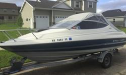 That's right it only has 123 hrs on the Bayliner. Its not even broken in! Its been stored most of the time. Its in great running shape. 90 horsepower engine. A sleeping area with a full camper top enclosure. It needs nothing but a new owner who would use