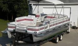 1991 Seanymph Sun Cruiser 24 foot pontoon and 1992 Trail Star dual axel trailer with hydraulic tongue break. This boat has everything you need to hookup and go. This boat has a Johnson single outboard 60HP motor that cranks with ease. It comes with two