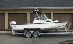 1992 22FT Commercial Grade Boston Whaler Sentry 200HP w/ TrailerHull ID: BWC5J165L192It is built by Brunswick, the commercial division of Boston Whaler.The outer hull is identical to the 22' Outrage only the Sentry weighs more do to extra laminate in the