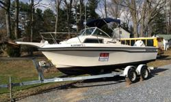 Boat is a 1992. Motor is a 2000Here is a list of some of the extra features on the boat as follows:Windlass anchor wenchComplete built in stereo system with 500watt marine amp.Garmin GPS fish finder / DepthStainless steal tripod for skiing and tubing1