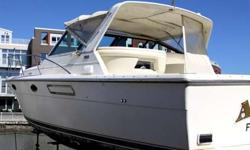 This Tiara 3100 Sport Fisherman Open is in very good condition and has been professionally maintained by its current owner who is a marine mechanic. The boat exterior features a swim platform w/telescoping ladder, walk-through transom w/latching door, a