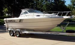 1993 Proline 220 Cuddy Fish with 350 cubic inch, 250 horsepower Mercruiser Magnum engine in excellent condition! Bravo 1 Outdrive rated to 800 hp S.S. prop. Fresh water usage since new with approximately 350 hours. Also included is a 2005 EZ Loader all