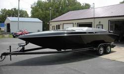 1994 BAJA BANDIT 223 SE RARE ALL BLACK. This is a rare bandit, that is all black. Boat is in excellent shape. New front and rear seats along with the engine hatch all last year. Boat has an hour meter but I unhooked it when I put a rebuilt 454 Mercruiser