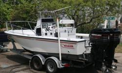 1994 Boston Whaler 21' Outrage with twin 1994 Mercury 150 hp EFI and a 2012 Load Rite Trailer. This boat has been meticulously cared for and maintained since she was purchased. I am the 2nd owner of the boat and have owned her for the last 8 years (450