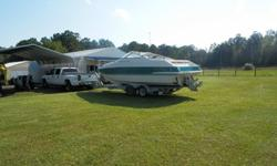 Offered here is very fine 25' Chris Craft cabin cruiser that includes the following: 2005 Load Trailer w/hydraulic brakes; 7.4 newly rebuilt engine (0 hours); Racing exhaust manifolds; 2 new marine batteries; Bimini Top; Boat Cover; Volvo Dual Prop; Fresh