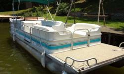 24 foot pontoon with 8 wheel trailer. The trailer has only been used twice.Mercury 70 hsp motor. In great condition-newly upholstered seats, new carpet. Seats 8-10 people. Has great under seat storage, portable table top for front or back of boat, covered