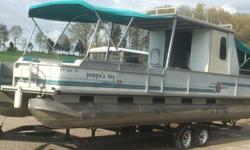 ,,,,,,,1994 Tracker Party Hut has seen very little use. The seats, bimini tops, carpets, and other canvas are in good condition. The galley has a new counter top, and includes a propane cook top and sink with water pump. Tanks for fresh water and gray