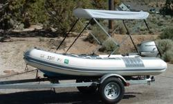 11 foot Novurania is in excellent condition. Fiberglass bottom, inflatable tubes, all in great shape. No holes, holds air as it should, year round. Fun boat for cruising around the lake, harbor or river. Powerful motor gets it onto plane quickly. Includes