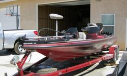 1996 Skeeter 200ZX Bass Boat, equipped with dual live wells, 24 volt trolling motor, Lowrance fish finder and GPS, complete on board charging system, and a 200EFI horse power Mercury. Tandem axle trailer with chrome wheels. The boat is in very good