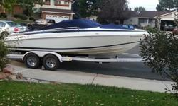 """This 1996 Cobalt 200 is Navy/White with 500 hours. It's powered by a 5.7 LX V8 Thunderbolt V Ignition MerCruiser engine with 190 HP. IT's length is 20 feet long with a beam of 8'2"""". Equip with this boat is a bimini, boat cover and the trailer. It has a"""