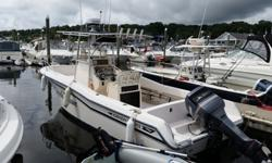 This 1996 Grady White 247 Strike Center Console Is Loaded With Equipment And Ready To Fish ** She Is Powered By The Highly Reliable And Economical Yamaha 225 Two Stroke Outboard Motor ** She Has A New SS Prop In 2014($588) ** New Garmin 540S HD GPS/Radar