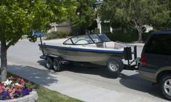 1996 MB Sports Boss 210 open-bow tournament ski boat in good condition. A DHM dual-axel trailer is included, along with a boat cover. One owner.The boat has been covered at all times when not in use. It has received regular maintenance as needed, notably