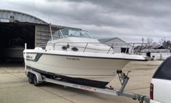 the condition of the boat is very good ,and the floors are solid as a rock ,,there is a lot of space to fish from and stainless steel pole holders for trolling or just holding your poles ,,it has a bimini top with some pole holders on it ,and a mooring