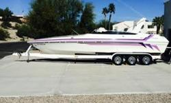 Lake ready in great condition loaded with options and amenities. Mercruiser 502 Magnum with Bravo One outdrive, depth finder, tilt power steering, drop down bolster bucket seats, bimini top, sliding cabin door, mid cabin, wet bar,blender, AM-FM Multi-CD