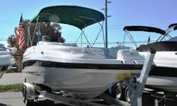 Wow!!! This 1997 Chaparral 24 foot 232 Sunesta deck boat is in fantastic condition inside and out and loaded to the GILLS with cool options. It comes with a huge bimini top, walk through transom, giant open bow with built in cooler and huge ski locker,