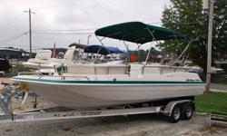 Gorgeous, ultra clean 1997 Hurricane 230 Deck Boat for sale with Volvo 5.7 liter 350 cubic inch small block V8. This boat has it all including: Bimini top, snap on cover, docking lights, huge front deck with (2) fishing seats, front and rear entry, full