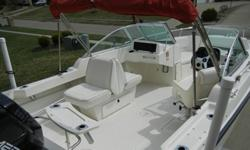 This is a pristine white, two owner boat that has low hours and has been meticulously maintained, powered by the bullet proof Mercury 175 HP EFI engine. Always kept under cover. Gelcoat is excellent and shines like new. Boston Whaler Ventura 20 is a 19