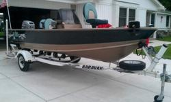 1998 Lund Explorer SS.1998 Karavan trailer.1997 Mariner 30 HP Motor.power tilt.Two stroke, no trolling motor, fish finder, gps. Drivers seat stays put but swivels, three others can go in four different places, front and rear casting platforms. Very good