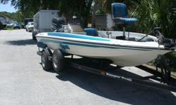 RARE find- one owner 1998 Ranger R91 bass boat with factory matching Ranger trailer WITH disc brakes!200HP Johnson Venom which runs perfect. SS prop.Trailer has new tires, wheel bearings and grease. Ready to go.swim ladder, depthfinder, spotlight. 47 gal