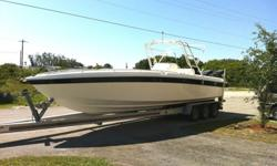 This boat was just serviced with new plugs, new filters, new oil,New water impellers, new windshield and new livewell pump, All systems were checked including engine compression which was great on both engines.New tinted Windshield (Just installed)Blue