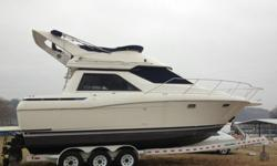 Air conditioner hose was lose and boat got water in engine compartment and stern of the boat partially submerged in fresh water. It was removed from water right away, water was drained from all systems, engines were flushed and boat was cleaned. It was