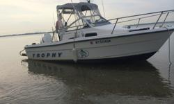 Sports Fishing Boats, Cuddy Cabin or Offshore boat for sale1999 Bayliner Trophy 1802 Walkaroundwith outboard 2007 ETEC Evinrude 115 HP (runs excellent) & Tachometer Etec Evinrude Outboard E-TEC System Check Tach,Comes with registered a Single Axle