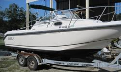 1999 Boston Whaler 21 Conquest, 1999 Mercury 200 EFI 2-Stroke (302 Hours),Trailer As Shown Included.This very well maintained vessel is solid, clean and pretty. It comes Complete with Bimini Top, Ritchie Compass, Hummingbird Fish Finder, Uniden VHF Radio