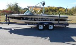 Competition Wakeboard/Ski boat: D-drive with Upgraded PCM Pro Boss GT 40 5.8 liter V8!! This Boat is super nice with 434 Hours of fresh water!!!! It comes with matching dual axle trailer. Depth finder, ballast system, walk thru transom, docking lights, Cd