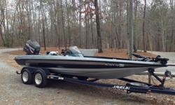 ,,,,,1999 Javelin Renegade 20ft Bass Boat with 225 HP Johnson H/O. Runs Great! Good Condition, Hot Foot with Steering Wheel Mounted Trim Controls, ProAir Livewells, New Tour Series Boat Seats, New MinnKota Edge 70lb Thrust Foot Control Trolling Motor, New