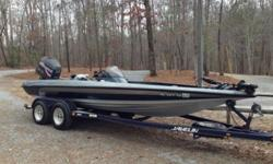1999 Javelin Renegade 20ft Bass Boat with 225 HP Johnson H/O. Runs Great! Good Condition, Hot Foot with Steering Wheel Mounted Trim Controls, ProAir Livewells, New Tour Series Boat Seats, New MinnKota Edge 70lb Thrust Foot Control Trolling Motor, New
