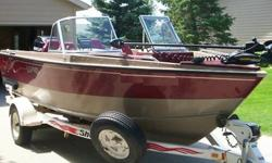 1999 Lund 1800 Fisherman (Adventure Series), Vinyle Floor Option, Mercury 135hp OptiMax O/B, Vengeance Stainless Steel Prop, Shoreland'r EZ Load Roller Trailer, 1 Peice Custom Made Snap On Travel Cover, Lund Mooring Storage Cover, Minn Kota 65lb Thrust