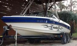 """1999 Malibu Sunsetter VLX with 2004/2005 Wakesetter graphics. It has a 325hp Monsoon motor with around 2K hrs. This is a one owner boat that been used on Lake Austin 99% of its life. The VLX hull was known as one of the """"Big 3"""" wakeboard hulls of the late"""