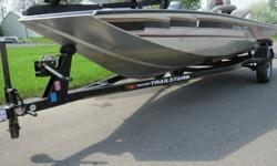 """very nice. 1999 tracker marine """"bass tracker"""" special edition pro team 175.mercury 40 power plus series with tilt and trim.trail star trailer with 3 new tires.pro series 40 trolling motor 43 pounds thrust.newer batteries two of them.center counsel.5"""