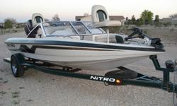 1999 Nitro Fish and Ski: 18 foot long, has full walk thru windshield, 120 horsepower motor, power motor trim that has 2 controls one at the front of the boat and the drivers seat, stainless steel prop, 12/24 volt trolling motor, 2 aerated live wells(one