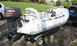 1999 ZODIAC Yachtline 340 DL (RIB) Rigid Inflatable boat with, BRAND NEW INFLATABLE TUBES AND MOTOR INSTALLED 2013 AND READY TO GO FOR SUMMER**!!!! 11 ft. clean white and grey exterior in very good condition, single outboard, fiberglass reinforced hull,