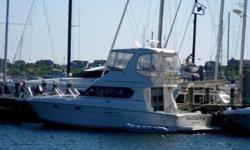 Whether you like to Cruise, Fish or just sit at the dock, this 42' Silverton Convertible is in prime condition, professionallymaintained with CAT 420 HP Diesel engines; Flybridge Hardtop; Furuno radar; Northstar color GPS; depthfinder; Autopilot; fish
