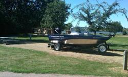 This is a Pro Guide V 175 WT -It has a 115 4 stroke Mercury motor. Has a bow mounted Minn Kota Trolling motor and we have added a Minn Kota 3 bank onboard charger and comes with 3 battery's. It has 2 live wells, depth and fish finder . Boat comes complete