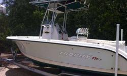 Runs Great, versatile Trophy 21 Center Console, 200HP Mercury EFI, T-Top, Live Bait well, Fresh water tank , swim ladder, great all around family boat and low maintenance, Navman GPS/Fishfinder includes new aluminum trailer, water toy and water skis, life