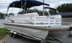 This is the deal of the year!! Here is a very nice 26 foot hi-end tritoon pontoon boat ready to go to the water for under 20K. This boat has a double bimini top, Clarion CD stereo system, refreshment center, full instrumentation, depth finder, table,