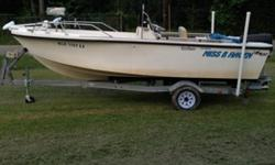19 foot center console boat. Ready for the water and fishing. Very well taken care of and maintained. 140 Evinrude outboard motor--runs great, brand new prop. Minn Kota trolling motor with new prop. Totally rebuilt trailer with brand new tires. Lowrance